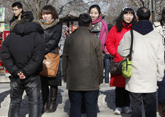 Participants talk to each other during a matchmaking event to look for potential partners at Ditan Park in Beijing