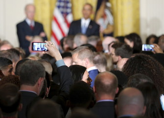 A heckler is removed for an extended interruption of Obama as he plays host to a reception to observe LGBT Pride Month in the East Room at the White House in Washington