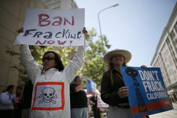 Denise Truong, 21, and Elizabeth Lerer, 51, protest against fracking in California