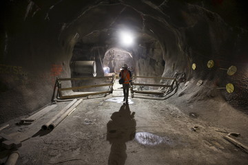 Media and workers walk in a tunnel in the East Side Access project, more than 15 stories beneath Midtown Manhattan where workers are building a new terminal for the Long Island Railroad in New York
