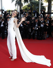 """Actress and model Cansu Dere poses on the red carpet as she arrives for the screening of the animated film """"Inside Out"""" out of competition at the 68th Cannes Film Festival in Cannes"""