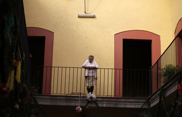 Former sex worker stands on the indoors balcony of Casa Xochiquetzal, a shelter for female sex workers, during Christmas celebrations in Mexico City