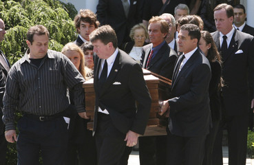 Mary Kennedy's casket is carried out of St. Patrick's Church by family after her funeral service concluded in Bedford