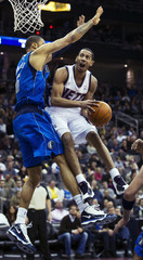 New Jersey Nets Harris goes for layup against Dallas Mavericks Chandler in their NBA basketball game in Newark