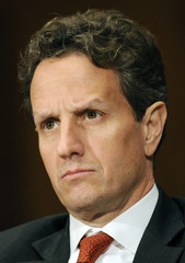 Geithner listens to opening statements from the Congressional Oversight Panel created to oversee the expenditure of the Troubled Asset Relief Program (TARP) on Capitol Hill in Washington