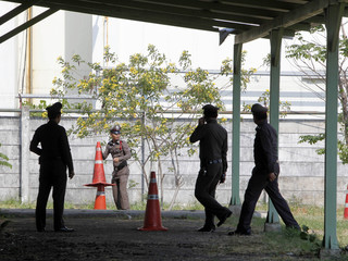 Policemen investigate the site of an explosion at the Public Health Ministry after a cabinet meeting in Nonthaburi province