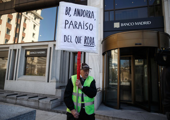 A man protests while holding a banner in Madrid