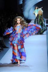 Models present creations for French house Dior during Haute Couture Fall-Winter 2011/2012 fashion show in Paris
