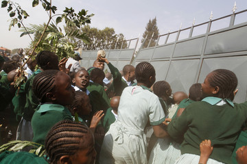 Students from Langata primary school attempt to break through a gate during a protest against a perimeter wall erected by a private developer around their school playground in Nairobi