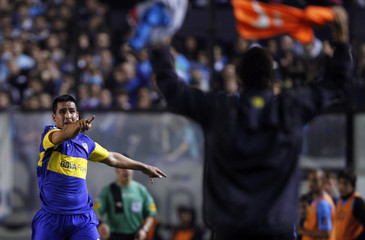 Boca Juniors' Lucas Viatri celebrates after he scored a goal against Racing Club during their Argentine First Division soccer match in Buenos Aires