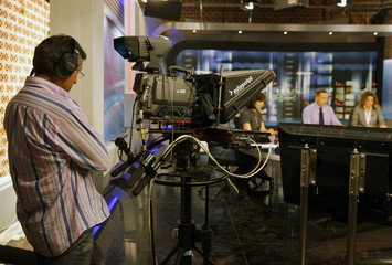 A cameraman of state broadcaster ERT films in a studio of the station in Athens during a live broadcast