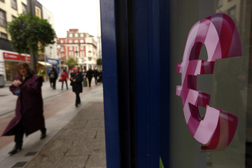 A sign displaying the Euro symbol is seen on a shop window in Dublin city centre