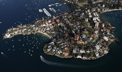A boat goes around Point Piper on a sunny winter afternoon in Sydney