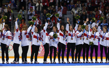 Bronze medallists Switzerland's players celebrate after the women's ice hockey gold medal game at the Sochi 2014 Winter Olympic Games