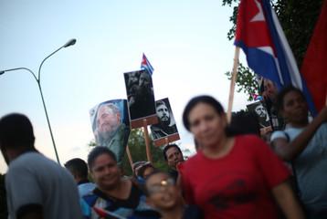 People wait in line to pay tribute to Cuba's late President Fidel Castro in Havana