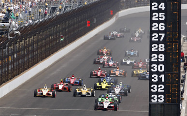 The cars come around at the start of the Indianapolis 500 auto race at the Indianapolis Motor Speedway in Indianapolis