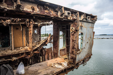 Rusty remnants of Russian warship sawed for scrap metal