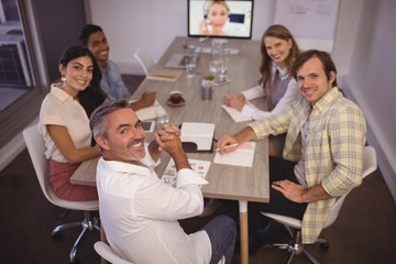 business people attending video conference meeting
