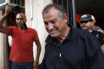 Ronda's ex-mayor Lara smiles after registering with the police in his office, following his arrest in Ronda