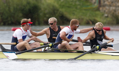 First placed Eric Murray and Hamish Bond of New Zealand celebrate with third placed George Nash and William Satch of Britain  after winning the Men's Pair Final event during the London 2012 Olympic Games at Eton Dorney