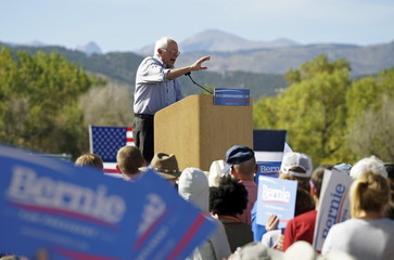 Democratic presidential candidate Bernie Sanders speaks to a  crowd against a Rocky Mountain backdrop at the University of Colorado in Boulder