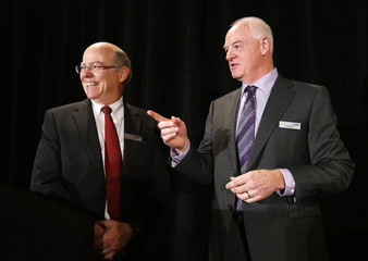 Jackson and Reinhart talk before the start of Nexen special meeting of shareholders in Calgary