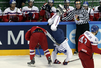 France's Roussel falls next to  Nemecof of the Czech Republic during their Ice Hockey World Championship game in Prague