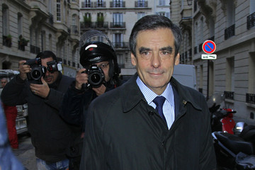 Fillon, former French Prime Minister and former candidate for the leadership of the UMP political party, leaves his apartment in Paris