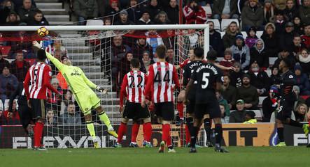 Liverpool's Daniel Sturridge scores their first goal