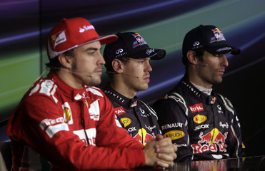Ferrari Formula One driver Alonso, Red Bull's Vettel and team mate Webber attend a news conference after the Indian F1 Grand Prix at the Buddh International Circuit in Greater Noida