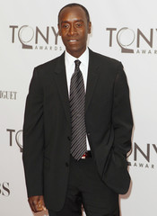 Actor Don Cheadle poses as he arrives during the American Theatre Wing's 65th annual Tony Awards ceremony in New York