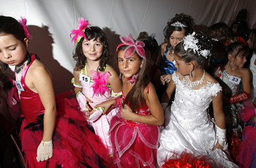"""Contestants wait backstage at the """"Mini-Miss"""" elegance beauty contest in Bobigny"""