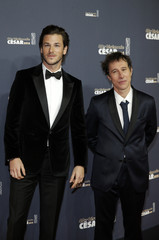 Actor Gaspard Ulliel and director Bertrand Bonello pose as they arrive at the 40th Cesar Awards ceremony in Paris