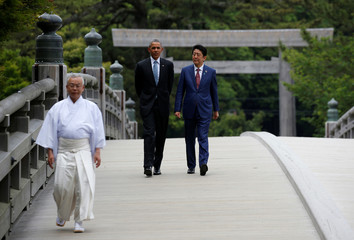 U.S. President Barack Obama talks with Japanese Prime Minister Shinzo Abe as they visit Ise Grand Shrine in Ise, Mie prefecture, Japan ahead of the first session of  the G7 summit meetings.