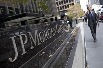 A man walks past JPMorgan Chase & Co's international headquarters on Park Avenue in New York