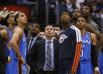 Oklahoma City Thunder coach Brooks and players wait for a referee's decision during their NBA basketball game against the Los Angeles Clippers in Los Angeles