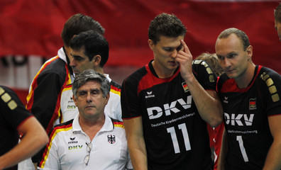German head coach Lozano and players Kampa and Popp react during the Volleyball European Championship Group D preliminary match against Poland in Prague