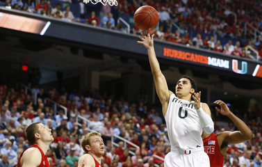 Miami Hurricanes guard Larkin shoots against the North Carolina State Wolfpack during the first half of their ACC Championship college basketball game in Greensboro