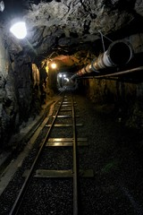 Old dark dangerous mine corridor