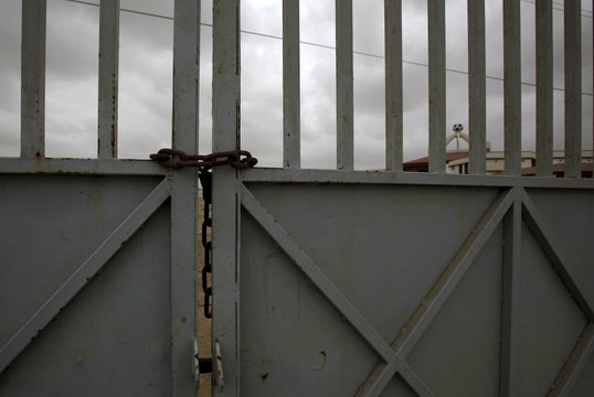 General view of chained and locked entrance gate at the FIFA Goal Project site in the Hawks Bay area of Karachi,