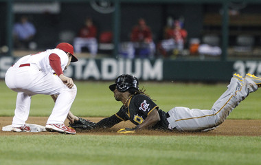 St. Louis Cardinals' Kozma tags out Pittsburgh Pirates' McCutchen as he tries to steal second base during their National League MLB baseball game in St. Louis
