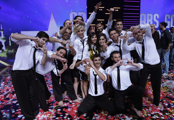 """Members of the Sima dance group of Syria pose for a photo after they were announced winner of the Season 3 finale of """"Arabs Got Talent"""" in Zouk Mosbeh area, north of Beirut"""