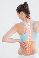 Rear view of woman suffering from pain