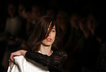 A model presents a garment by Australian fashion label Ginger and Smart at Australian Fashion Week in Sydney