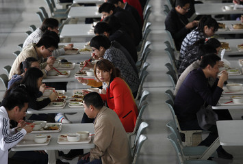 Huawei staff members eat lunch at a canteen of Huawei in Shenzhen