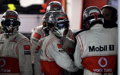 Pit crew get ready before a pit stop for McLaren Formula One driver Jenson Button of Britain during the Singapore F1 Grand Prix at the Marina Bay street circuit in Singapore