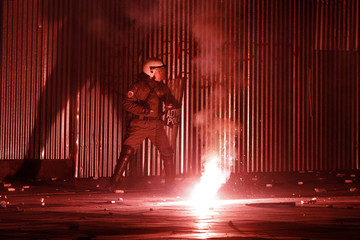 A riot policeman tries to protect himself during riots around Syntagma square in Athens