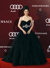 South Korean actress Leslie Han poses upon her arrival at the Asian Film Awards in Hong Kong