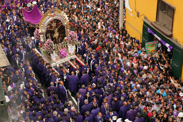 Believers attend the procession of  Senor de Los Milagros ( 'Lord of Miracles' ), Peru's most revered Catholic religious icon, in downtown Lima