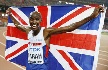 Mo Farah of Britain celebrates winning the men's 10,000 metres final at the 15th IAAF World Championships in Beijing